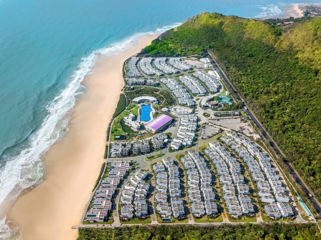 Backed by lush forested mountains and set on 22 hectares of prime beachfront, the resort is the ultimate seaside playground featuring 347 gleaming white villas cascading down from the mountain to the beach.
